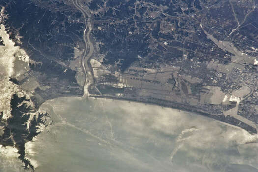 The 2011 earthquake off the Pacific Coast of Tohoku proved to be the worst earthquake in Japanese history and the fifth largest earthquake since 1900.  The quake sent tsunami waves into Japan and the surrounding Pacific area.  In this picture, you'll notice the flooding.  The hazy white areas are oil slicks from refineries damaged in the tsunami.   Over 15,000 people were confirmed killed and around 2,600 people went missing. (NASA)