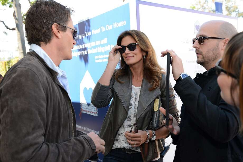 LOS ANGELES, CA - MARCH 10:  Rande Gerber (L) and Cindy Crawford wearing John Varvatos Eyewear at the 10th Annual Stuart House Benefit presented by Chrysler at John Varvatos Los Angeles on March 10, 2013 in Los Angeles, California.  (Photo by Michael Kovac/Getty Images for John Varvatos) Photo: Michael Kovac, Getty Images For John Varvatos