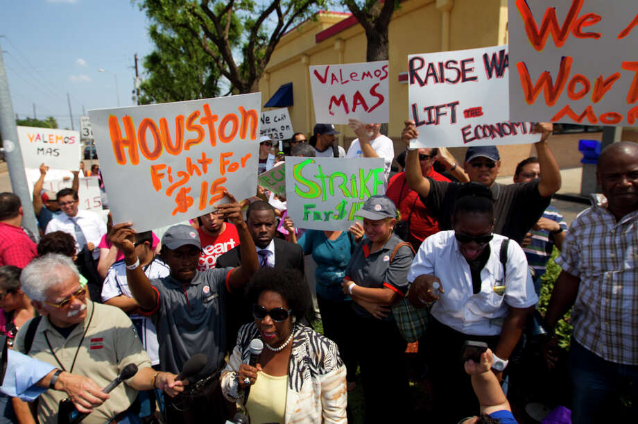 Congresswoman Sheila Jackson Lee rallies protestors in front of Burger King on Fountainview Drive near Richmond Avenue to protest wages paid to fast food employees,Thursday, Aug. 29, 2013, in Houston. Protestors joined the national movement to try and increase minimum wage to $15 per hour for fast food employees. Photo: Cody Duty, Houston Chronicle / © 2013 Houston Chronicle