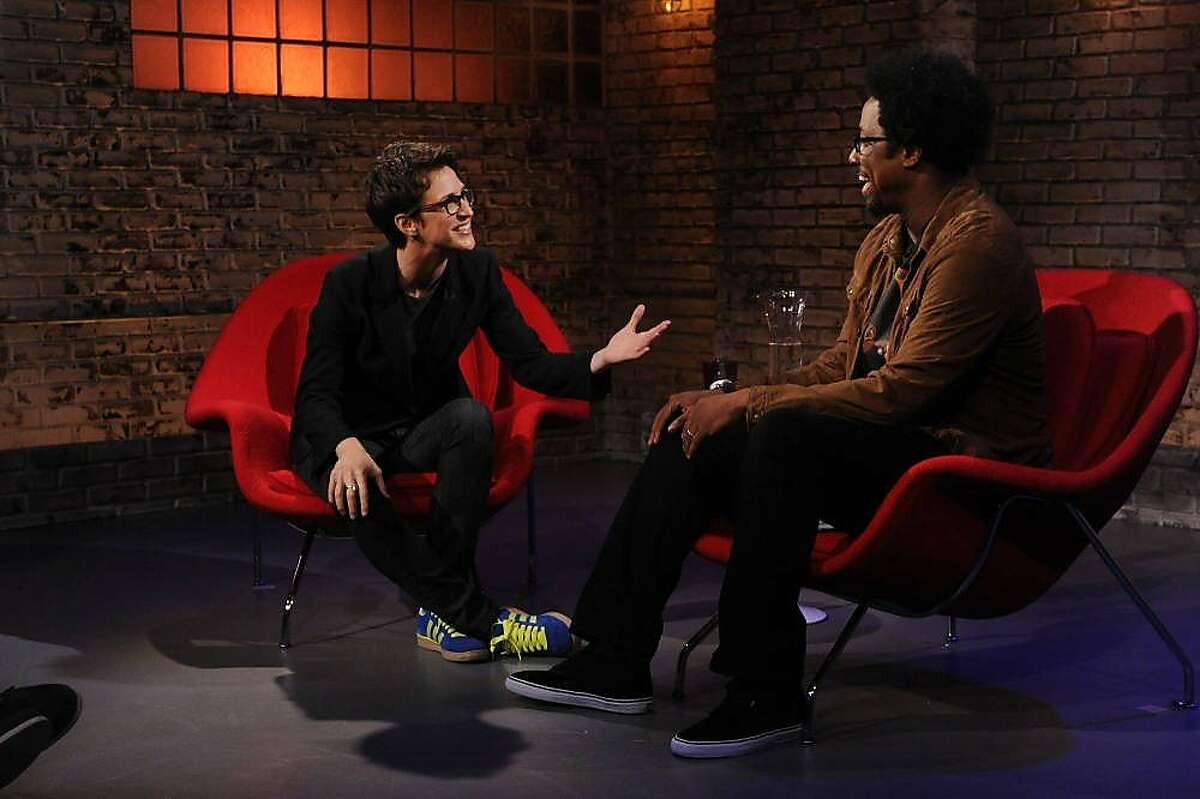 """W. Kamau Bell is about to launch the second season of his show """"Totally Biased With W. Kamau Bell"""" on the new FXX channel, a spinoff of the FX channel. Among his guests the first season was MSNBC's Rachel Maddow. TOTALLY BIASED WITH W. KAMAU BELL: Show 2 (Airs August 16, 11:00 pm e/p) Pictured: (L-R) Rachel Maddow, W. Kamau Bell. CR: Jeffrey Neira/FX"""