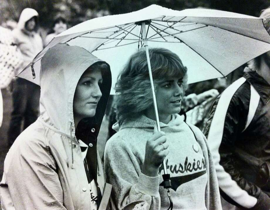 ... fluffy, perfectly feathered, 1980s hair. (Sisters Sally, left, and Julie Weber watch a Skyboys concert at Bumbershoot, 1982).  Photo: -
