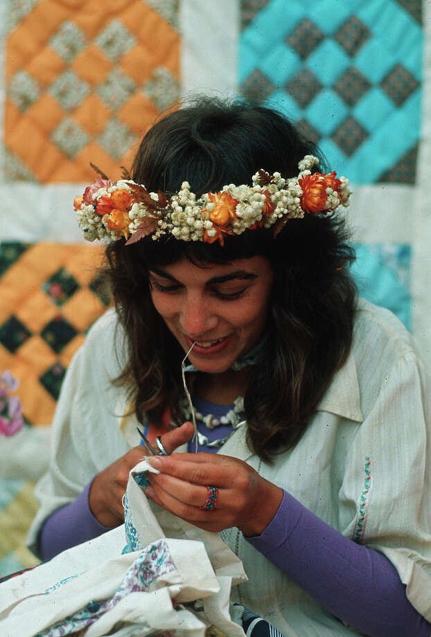 Bumbershoot fashion in the '70s was pretty great. There were flowered garlands, and ... (Photo: 1973).  Photo: -