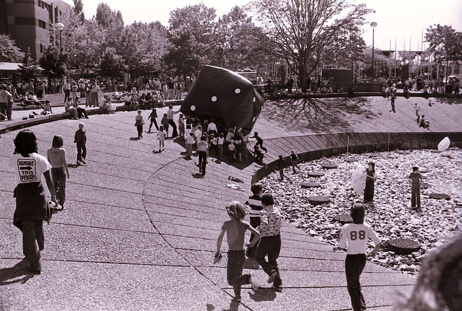 "Innocent fun, or dystopian youth? A Seattle Post-Intelligencer photographer who captured this same 1979 Bumbershoot scene in a different photo wrote with his caption, ""Little f***ers pushed (the die) into the fountain, where it was ripped apart."" That part of the caption wasn't published.  Photo: -"