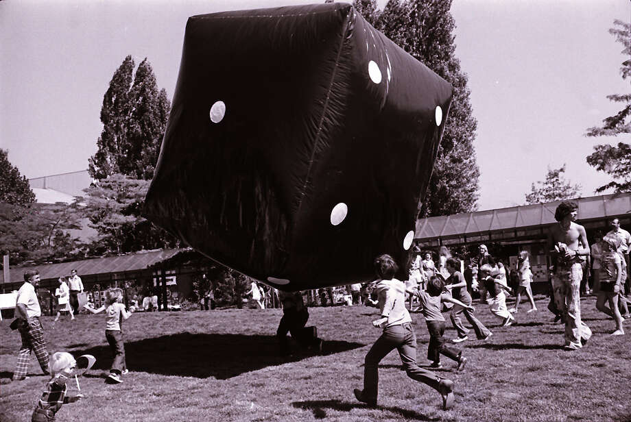 It was trendy for kids to bounce around giant Earth balls in the '70s. But at this 1979 Bumbershoot, it was a monstrous, blow-up die the kids kept aloft above the grass.  Photo: -