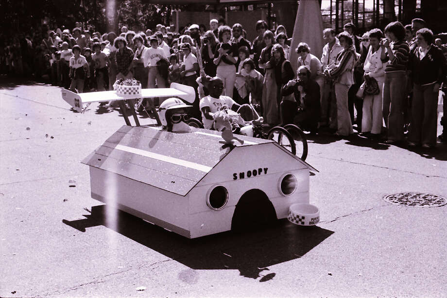 "Early Bumbershoots had a soap-box derby called the ""Bumbernationals,"" which brought crafty cars like this Snoopy doghouse on wheels in 1979.  Photo: -"