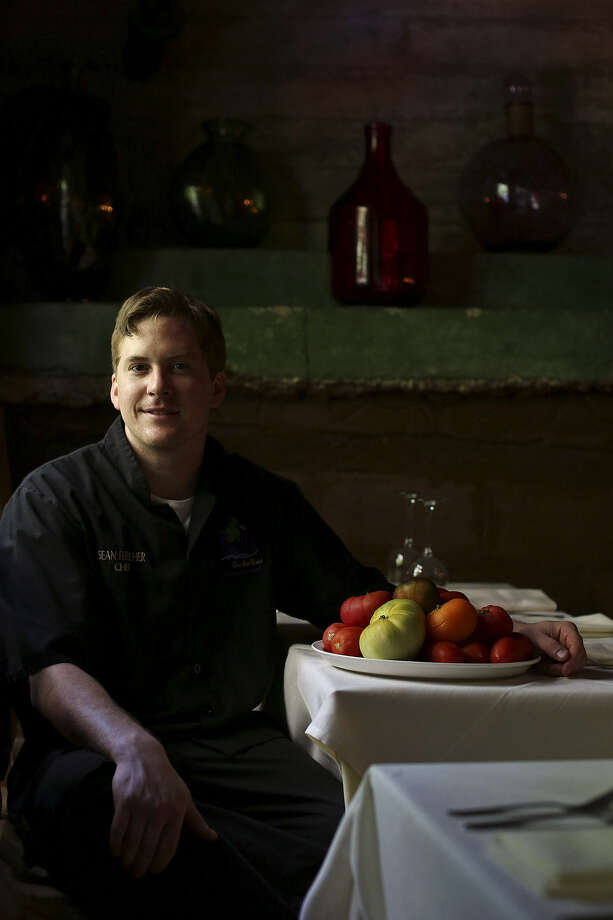 Bella On the River executive chef Sean Fletcher uses heirloom tomatoes for restaurant meals whenever the fruit is available. Photo: Lisa Krantz / San Antonio Express-News