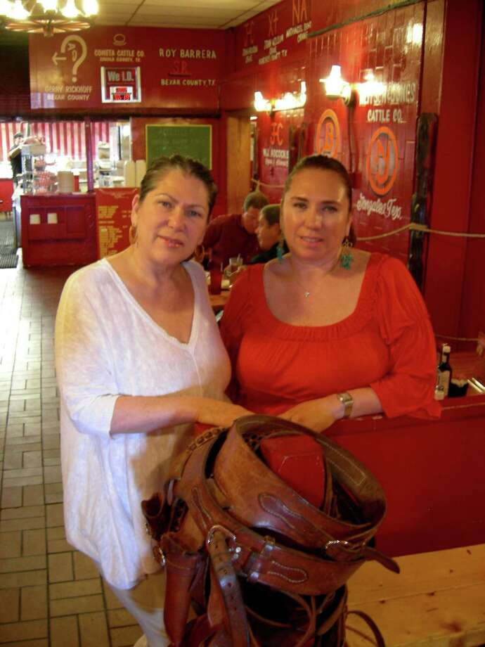 Nancy Hernandez (left) and Marissa Garcia are celebrating the 50th anniversary of the Little Red Barn Steakhouse.