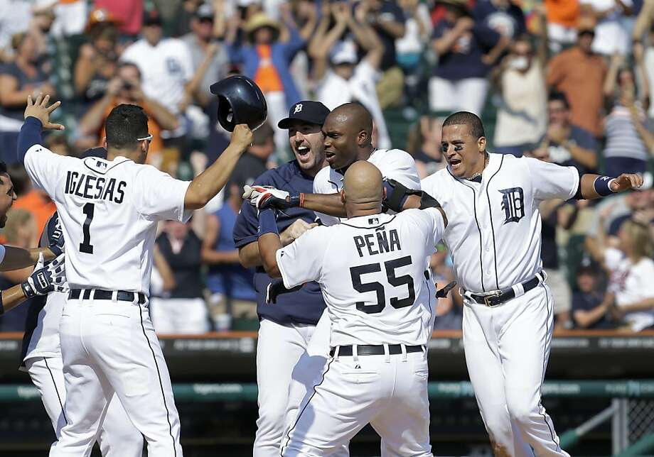 Torii Hunter (behind Brayan Peña) is Mr. Popular in Detroit after his game-ending homer. Photo: Paul Sancya, Associated Press