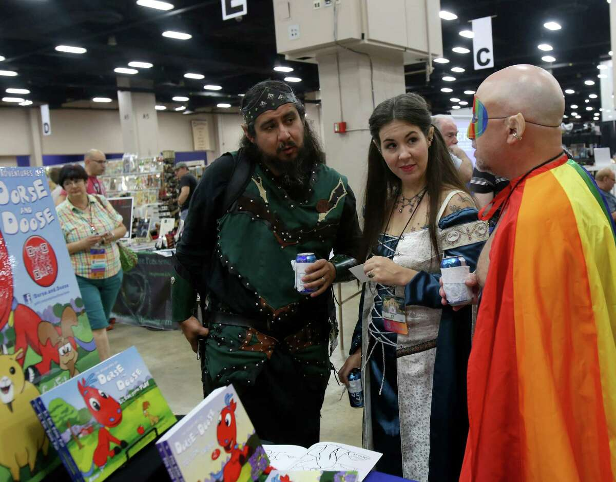 Marcus Garcia, Amber Nisely and Jay Aspinall dress in costumes for the 71st World Science Fiction Convention in San Antonio.
