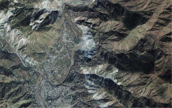 The 2005 Kashmir earthquake battered Pakistan, leading to the deaths of around a 100,000 people.  Pictured here is the the village of Makhri, just north of the city of Muzaffarabad, just about six miles (10 kilometers) away from the epicenter of that quake.  The face of the mountain collapsed, turning the normally blue river brown with dirt and engulfing parts of the surrounding area. (NASA)