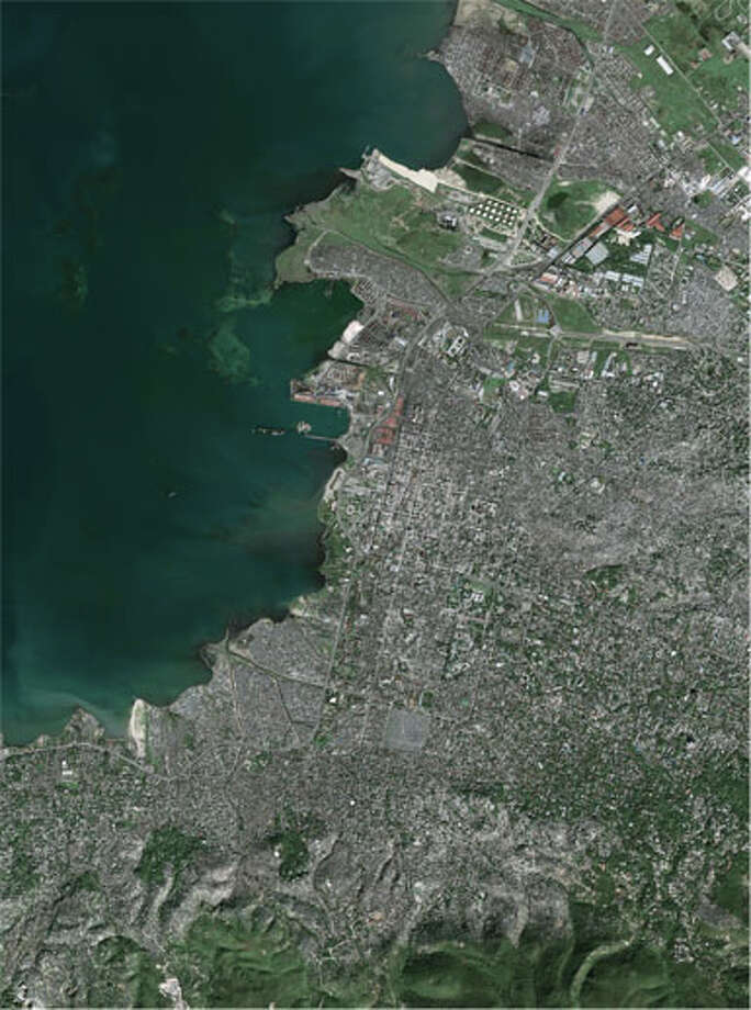 In January 2010, a 7.0 magnititude earthquake rocked Haiti, wrecking the capital city of Port-au-Prince.  Around 100,000 people were killed and many more were displaced.  While difficult to see, this satellite image of Port-au-Prince shows significant damage in densely populated neighborhoods. (NASA)