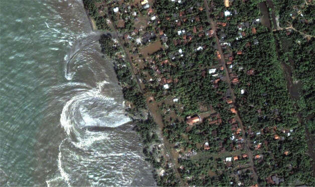 The 2004 Indian Ocean earthquake spawned a vicious tsunami that stretched as far as the Pacific Ocean.  Countries like Indonesia, Sri Lanka (pictured here), India and Thailand were the hardest hit and more than 230,000 people lost their lives.  This image was taken just one hour after the first series of waves hit the Sri Lankan coast. (NASA)