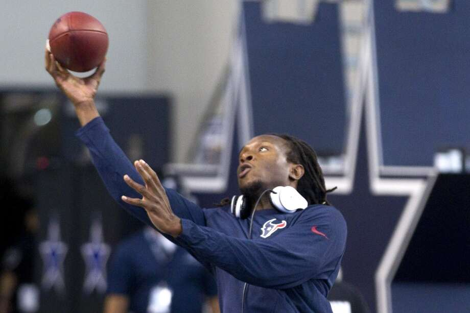 Texans wide receiver DeAndre Hopkins catches a football before the game. Photo: Brett Coomer, Houston Chronicle