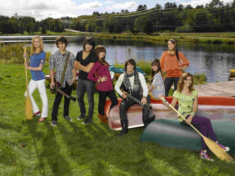 "In this image released by Disney Channel, the cast members, from left, Meaghan Jette Martin, Nick Jonas, Joe Jonas, Demi Lovato, Kevin Jonas, Anna Maria Perez de Tagle, Jasmine Richards and Alyson Stoner are shown in ""Camp Rock."" Photo: BOB D'AMICO, AP"