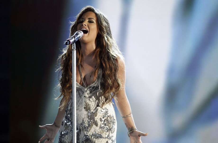 Demi Lovato performs onstage at the Do Something Awards on Sunday, Aug. 14, 2011, in Los Angeles. Photo: Matt Sayles, AP