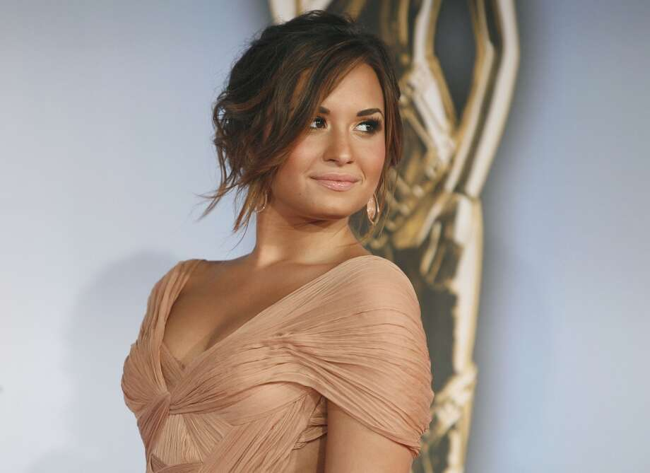 "Actress Demi Lovato arrives at the ALMA Awards in Santa Monica, Calif., Saturday, Sept. 10, 2011. The 2011 NCLR ALMA Awards are held to honor those who promote ""fair, accurate and balanced"" portrayals of Latinos in the entertainment industry. Photo: Jason Redmond, AP"