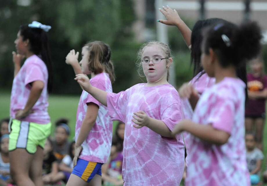Stephanie Batista, 10, of Danbury, cheers during the special needs cheerleading team's performance at Danbury Athletic Youth Organization cheerleaders practice at Rogers Park Middle School in Danbury, Conn. on Thursday, Aug. 29, 2013. Photo: Tyler Sizemore / The News-Times