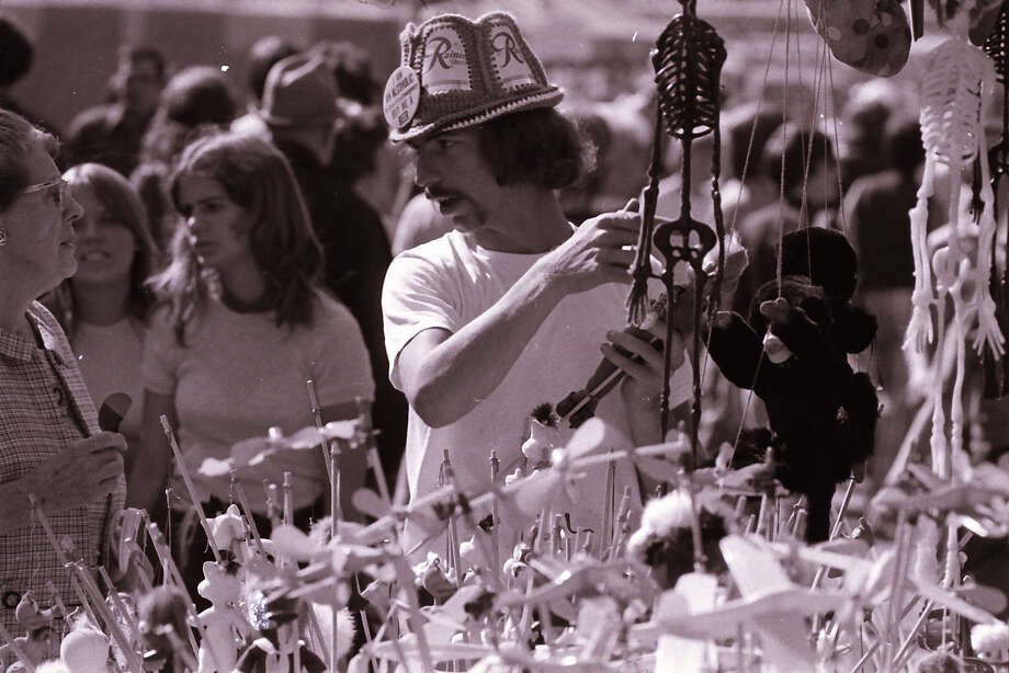 There's a lot going on in this photo, but the only thing that matters is that crocheted hat made with Rainier beer cans. (Bumbershoot, 1974).  Photo: -