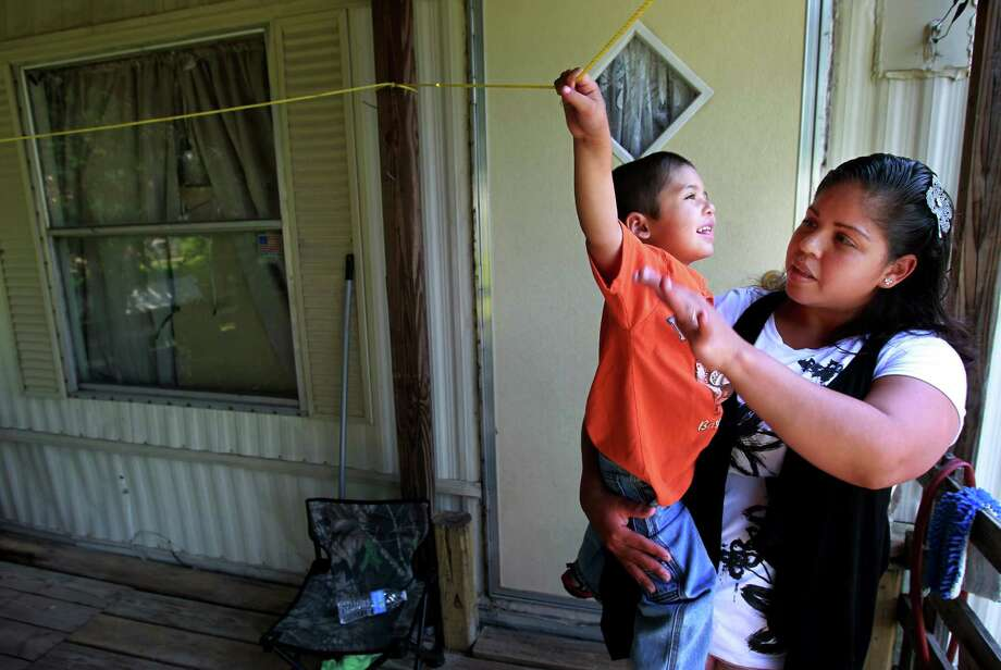 Sequestration cuts are forcing Marlen Rosas to defer her preschool dreams for her 3-year-old son Hector. Photo: Mayra Beltran, Staff / © 2013 Houston Chronicle