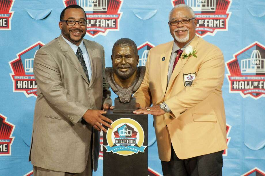 CANTON, OH - AUGUST 3: Chad Culp (L) and his father and former defender Curley Culp pose with his Hall of Fame bust during the NFL Class of 2013 Enshrinement Ceremony at Fawcett Stadium on Aug. 3, 2013 in Canton, Ohio. (Photo by Jason Miller/Getty Images) Photo: Jason Miller, Stringer / 2013 Getty Images