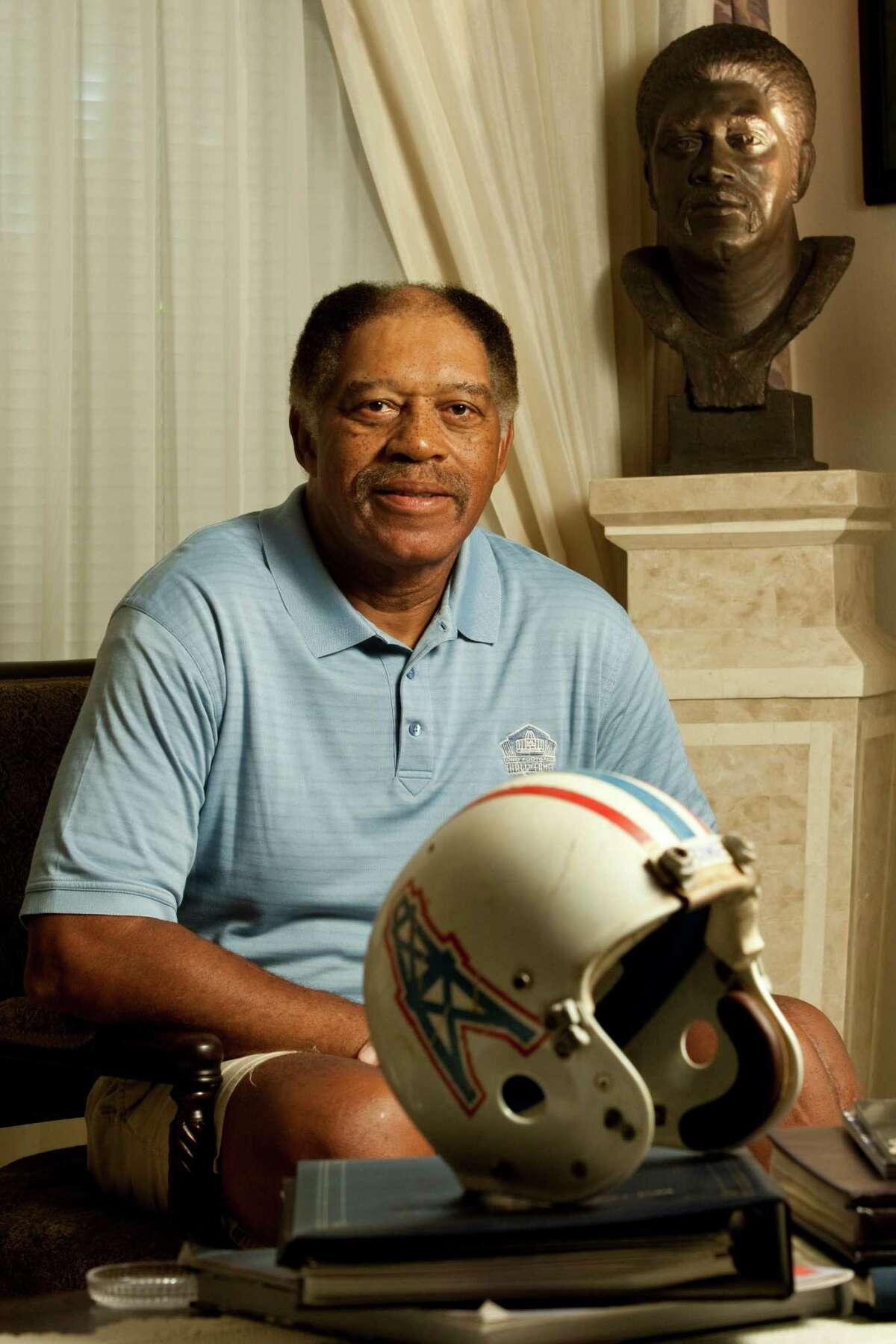 Houston Oiler great Elvin Bethea sits in front of his Hall of Fame bust Tuesday, Oct. 19, 2010, in his Missouri City home. Bethea played for 16-seasons and had an unofficial 105 sacks as a defensive lineman. ( Nick de la Torre / Houston Chronicle )