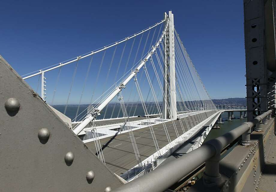 """After rejecting an austere """"freeway on stilts,"""" officials sought a more striking design, rising from the bay in sparkling white. Photo: Paul Chinn, The Chronicle"""