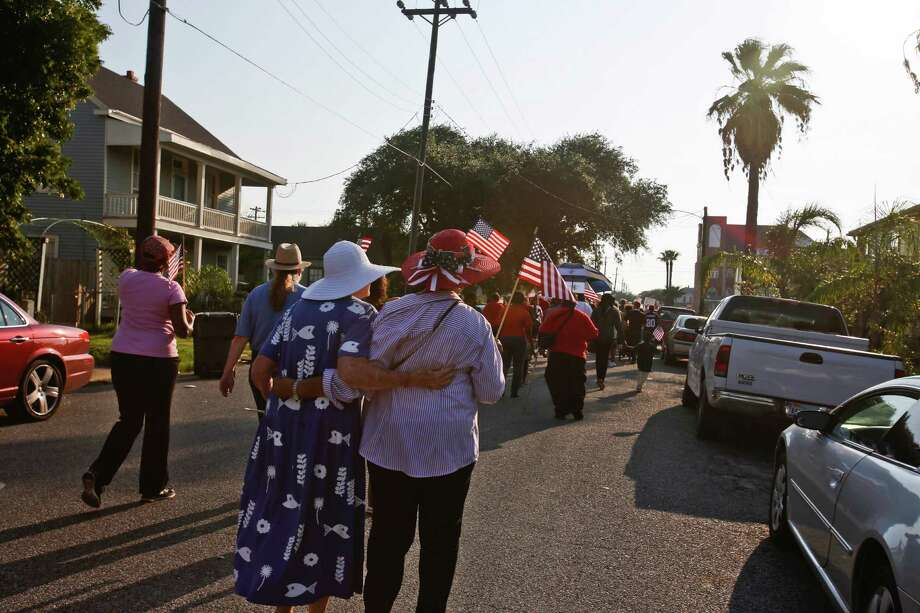 "Sharon Booton, left, and Cecelia Perry-Steptoe, walk shoulder to shoulder with other Galveston community groups who marched on the 50th anniversary of Martin Luther King's ""I had a dream"" speech to protest the failure to rebuild public housing five years after Hurricane Ike August 29, 2013 in Galveston, TX. The march ended at Avenue L Missionary Baptist Church at 2612 Avenue L to hear community leaders and clergy speak about housing and civil rights issues. Photo: Eric Kayne, For The Chronicle / ©Eric Kayne 2013"