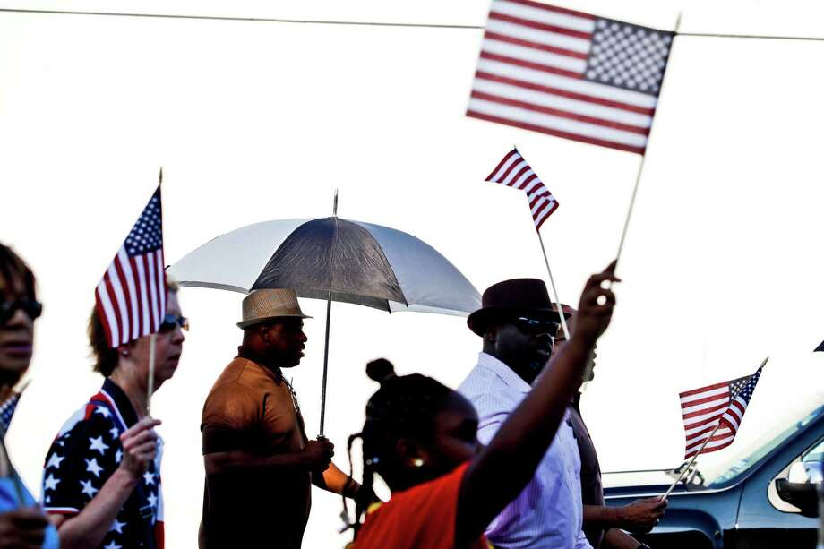 """Galveston community groups marched on the 50th anniversary of Martin Luther King's """"I had a dream"""" speech to protest the failure to rebuild public housing five years after Hurricane Ike August 29, 2013 in Galveston, TX. The march ended at Avenue L Missionary Baptist Church at 2612 Avenue L to hear community leaders and clergy speak about housing and civil rights issues. Photo: Eric Kayne, For The Chronicle / ©Eric Kayne 2013"""