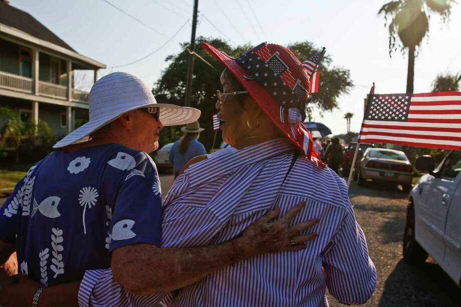 """Sharon Booton, left, and Cecelia Perry-Steptoe, walk shoulder to shoulder with other Galveston community groups who marched on the 50th anniversary of Martin Luther King's """"I had a dream"""" speech to protest the failure to rebuild public housing five years after Hurricane Ike August 29, 2013 in Galveston, TX. The march ended at Avenue L Missionary Baptist Church at 2612 Avenue L to hear community leaders and clergy speak about housing and civil rights issues. Photo: Eric Kayne, For The Chronicle / ©Eric Kayne 2013"""