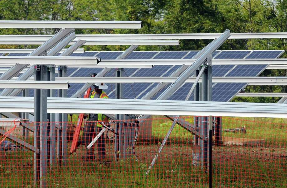 A solar farm is being built on a former corn field next to the Owens Corning plant Tuesday afternoon, Aug. 27, 2013, on Route 32 in Bethlehem, N.Y. (Michael P. Farrell/Times Union) Photo: Michael P. Farrell / 00023654A