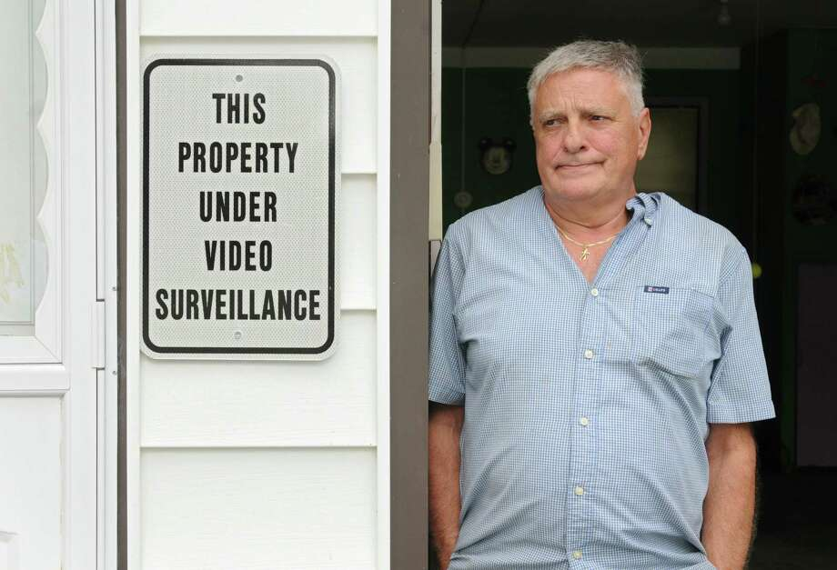 Fritz Dorr stands next to a sign by his garage Thursday, Aug. 29, 2013, where his Giant hybrid bike was stolen from in Colonie, N.Y. Dorr has placed a classified ad and $500 reward for  the return of his bike. (Lori Van Buren / Times Union) Photo: Lori Van Buren / 00023693A