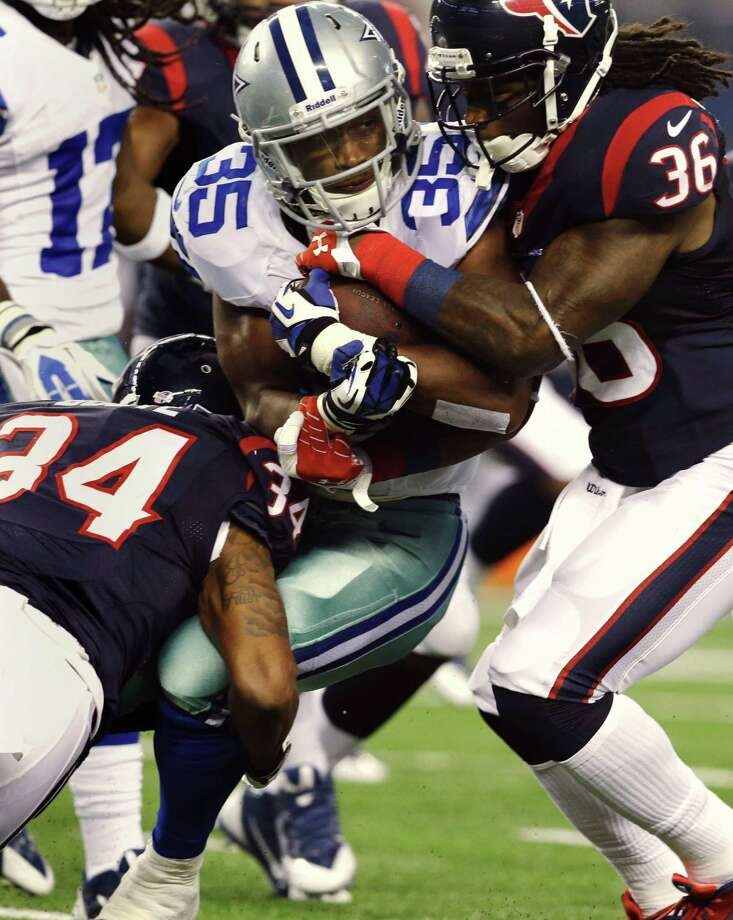 Dallas Cowboys running back Joseph Randle (35) is tackled by Houston Texans' A.J. Bouye (34) and D.J. Swearinger (36) during the first half of a preseason NFL football game Thursday, Aug. 29, 2013, in Arlington, Texas. (AP Photo/LM Otero) Photo: LM Otero, Associated Press / AP