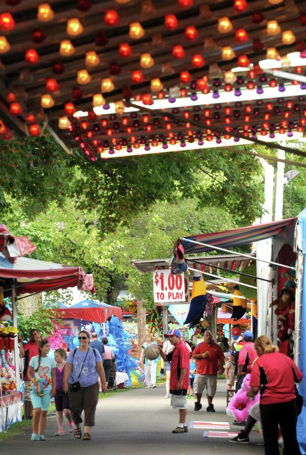A mellow midday midway is pictured during the second day of the Columbia County Fair Thursday afternoon, Aug. 29, 2013, in Chatham, N.Y. The fair runs Aug. 28-Sept. 2. (Michael P. Farrell/Times Union) Photo: Michael P. Farrell / 00023178A