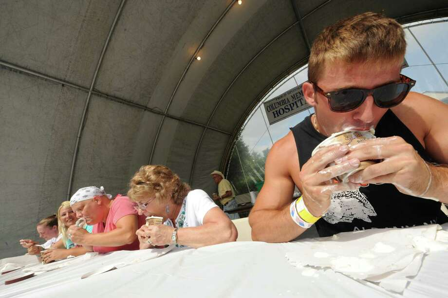 Seth Powell, right, of Chatham takes part in an ice cream eating contest Thursday Aug. 29, 2013, at the Columbia County Fair in Chatham, N.Y. The fair runs Aug. 28-Sept. 2. (Michael P. Farrell/Times Union) Photo: Michael P. Farrell / 00023178A