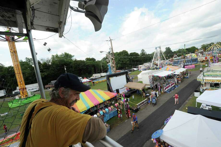 A mellow midday midway is pictured Thursday afternoon, Aug. 29, 2013, during the second day of the Columbia County Fair in Chatham, N.Y. The fair runs Aug. 28-Sept. 2. (Michael P. Farrell/Times Union) Photo: Michael P. Farrell / 00023178A