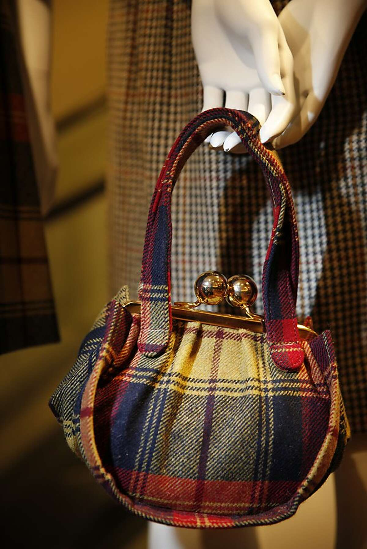 A purse is displayed in the new Brooks Brothers store in San Francisco, Calif.