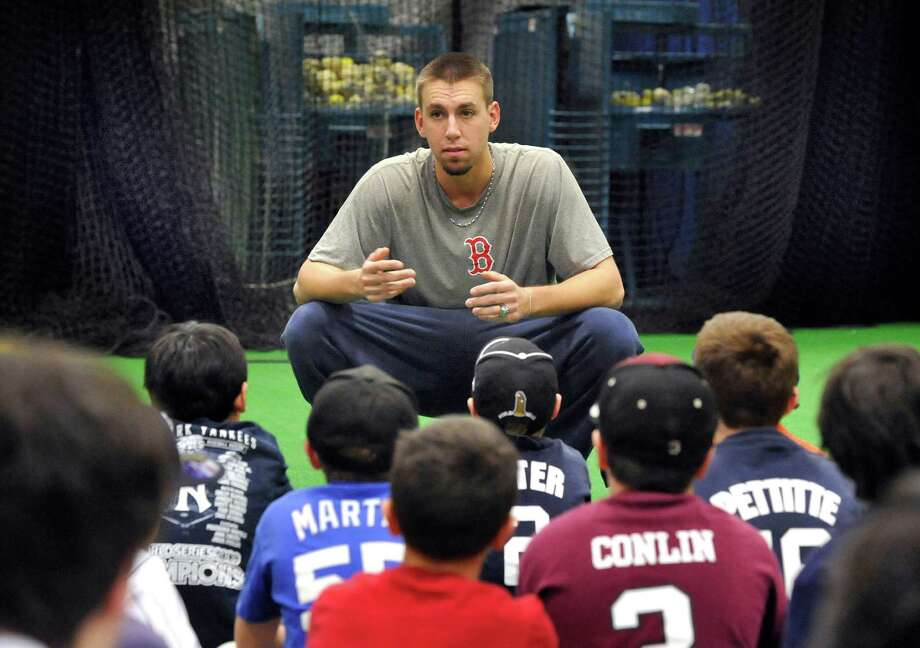 Red Sox prospect Matt Barnes, of Bethel, talks to young ballplayers during a clinic at Frozen Ropes in Danbury Saturday, Jan. 28, 2012. Photo: Michael Duffy / The News-Times