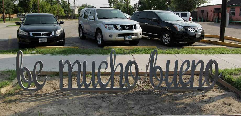 "An artist's use of ""Spanglish"" in the creation of a bike rack has caused dismay and puzzlement in an East End neighborhood. Photo: James Nielsen, Staff / © 2013  Houston Chronicle"