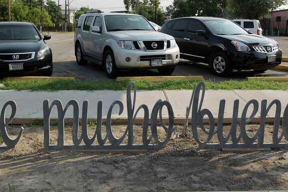 """An artist's use of """"Spanglish"""" in the creation of a bike rack has caused dismay and puzzlement in an East End neighborhood."""