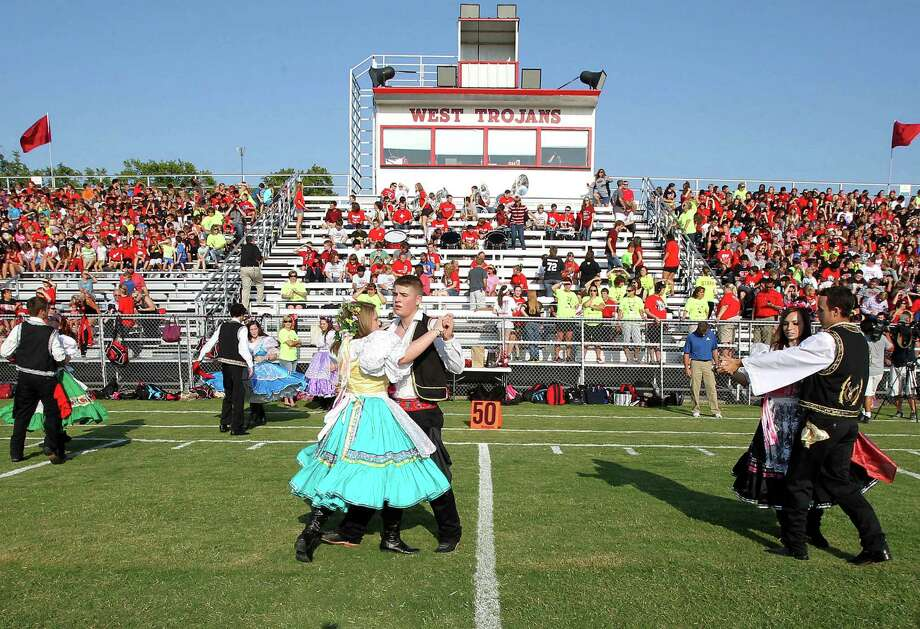 West High School's Junior Historian Czech Dancers perform at Thursday's morning pep rally on the field that served as a triage area after April's blast. Photo: Jerry Larson, MBO / Waco Tribune Herald