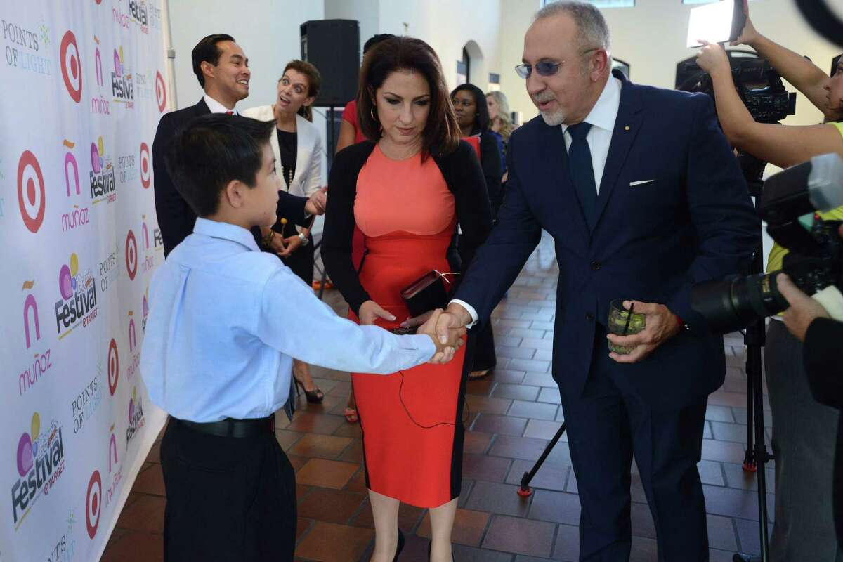 Sesbastien De la Cruz, left, the 11-year-old boy who sang the National Anthem while wearing a charro outfit during an NBA Finals game, meets Emilio and Gloria Estefan during the Points of Light national series of America's Sunday Suppers at the San Antonio Museum of Art on Thursday, Aug. 29, 2013.