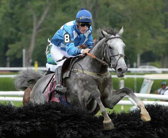 Bluegrass Summer makes the final fence on the way to the win in the first race of the day Thursday afternoon, Aug. 29, 2013, at Saratoga Race Course in Saratoga Springs, N.Y.   (Skip Dickstein/Times Union) Photo: SKIP DICKSTEIN