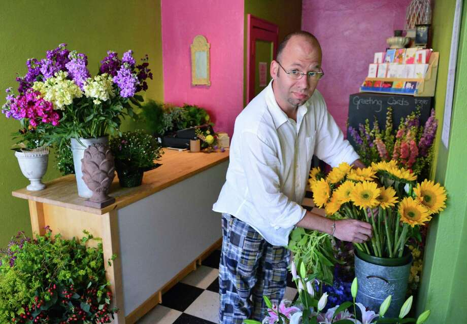 Louis Bannister inside his Columbia St. florist shop Wednesday August 28, 2013, in Albany, NY.  (John Carl D'Annibale / Times Union) Photo: John Carl D'Annibale / 00023667A