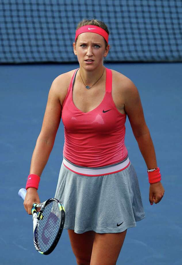 NEW YORK, NY - AUGUST 29:  Victoria Azarenka of Belarus reacts during her women's singles second round match against Aleksandra Wozniak of Canada on Day Four of the 2013 US Open at USTA Billie Jean King National Tennis Center on August 29, 2013 in the Flushing neighborhood of the Queens borough of New York City.  (Photo by Elsa/Getty Images) Photo: Elsa, Staff / 2013 Getty Images
