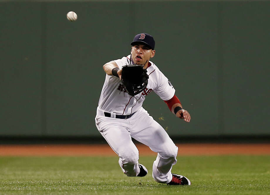 BOSTON, MA - AUGUST 29:  Jacoby Ellsbury #2 of the Boston Red Sox makes a lunging catch on Brian Roberts #1 of the Baltimore Orioles during the seventh inning of the game at Fenway Park on August 29, 2013 in Boston, Massachusetts.  (Photo by Winslow Townson/Getty Images) ORG XMIT: 163495265 Photo: Winslow Townson / 2013 Getty Images