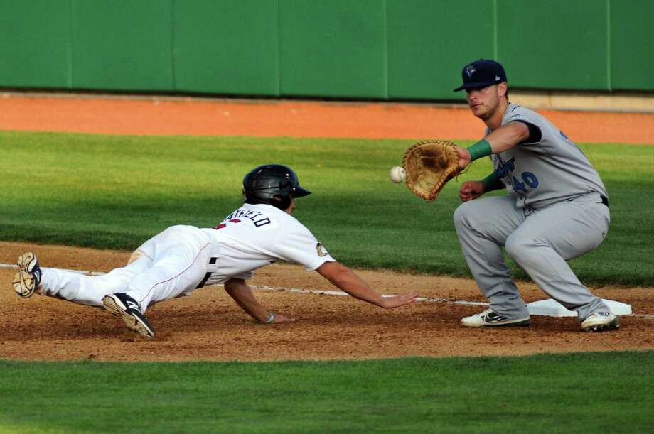 ValleyCats' Jack Mayfield, left, beats the throw to Vermont Lake Monsters' Ryan Huck at first during the first game of their doubleheader on Thursday, Aug. 29, 2013, at Bruno Stadium in Troy, N.Y. (Cindy Schultz / Times Union) Photo: Cindy Schultz / 00023638A