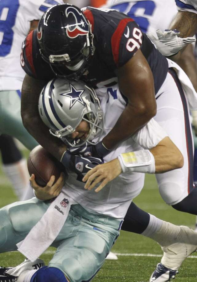 Texans defensive end Keith Browner sacks Cowboys quarterback Alex Tanney. Photo: Brett Coomer, Houston Chronicle