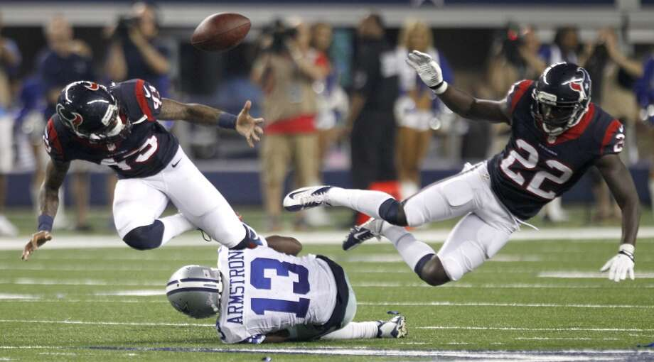 Texans defensive backs Elbert Wood and Roc Carmichael break up a pass intended for Cowboys wide receiver Anthony Armstrong. Photo: Brett Coomer, Houston Chronicle