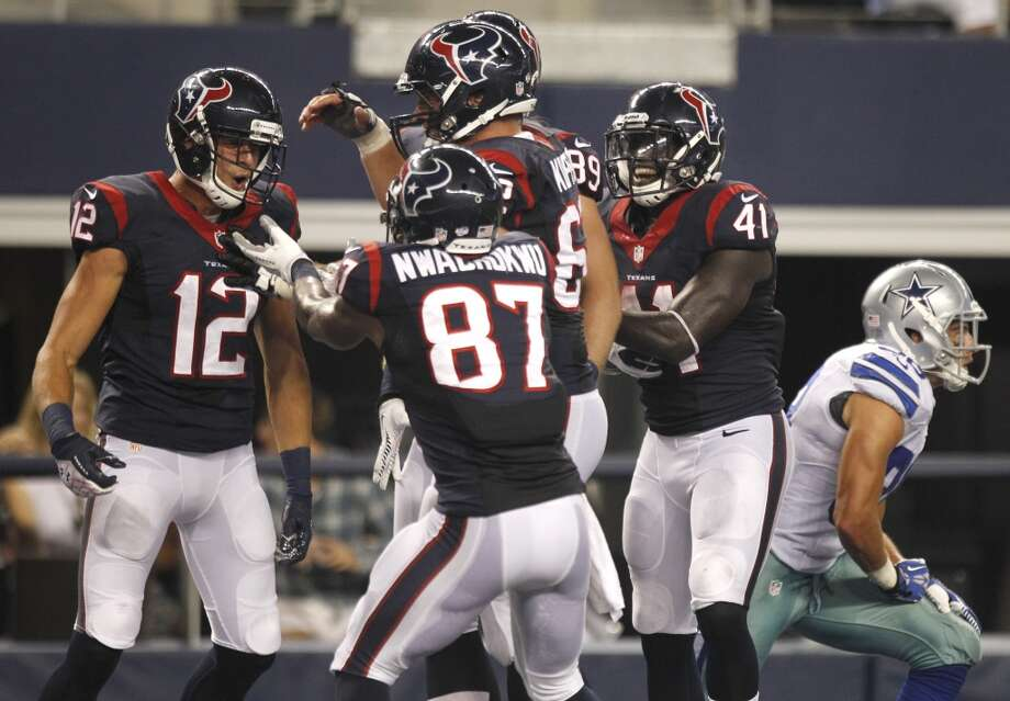 Texans wide receiver Andy Cruse celebrates his 21-yard touchdown reception against the Cowboys. Photo: Brett Coomer, Houston Chronicle