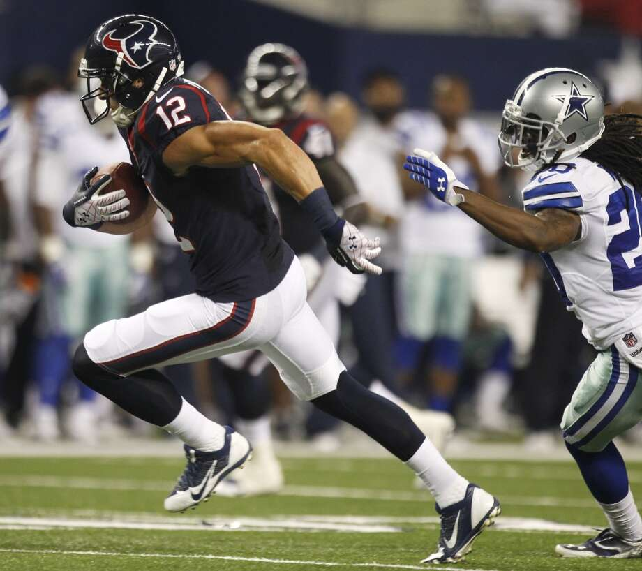 Texans wide receiver Andy Cruse sprints past Cowboys cornerback B.W. Webb for a 21-yard touchdown. Photo: Brett Coomer, Houston Chronicle